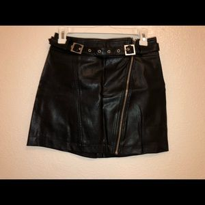 Black synthetic leather skirt.